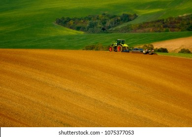 The tractor works on the fields, Moravia, Czech Republic