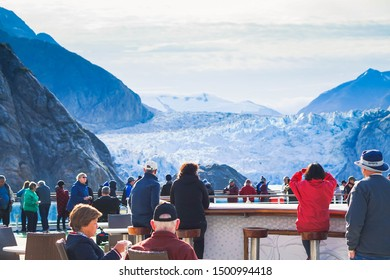 Tracy Arm Fjord, Alaska, USA August 20th 2019 Cruise passengers were up on the deck to see Tracy arm fjord. It is located about 45 miles south of Juneau and 70 miles north of Petersburg, Alaska