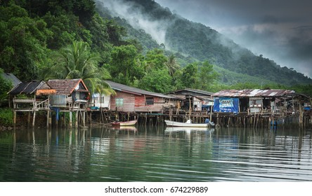 TRAD, THAILAND - JULY 10;2017: The wooden fishing boats and fisherman village in Koh Chang in rainy season.