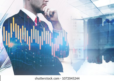 Trade and currency exchange concept. Thoughtful young businessman on abstract city forex chart background. Double exposure