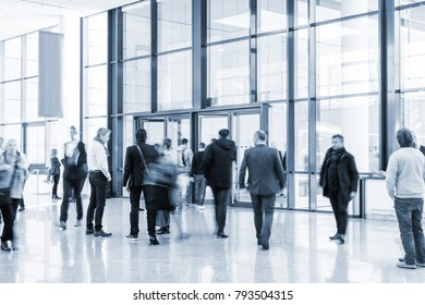 trade fair visitors walking in a clean futuristic corridor