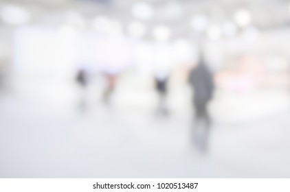 Trade show background with an intentional blur effect applied. Unrecognizable location.