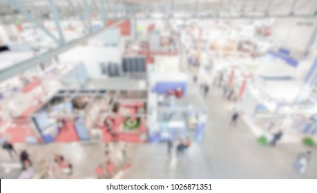 Trade show background with an intentional blur effect applied. People and location unrecognizable.