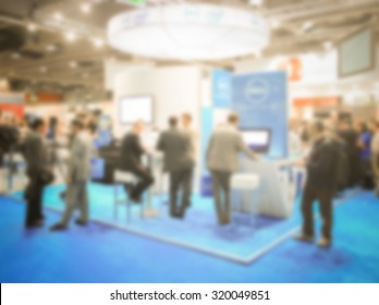 Trade show crowd generic background, intentionally blurred post production.
