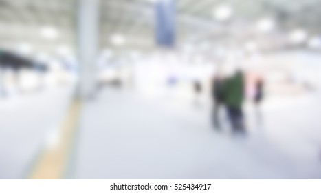 Trade show generic background with an intentional blur effect applied. People and location not recognizable.