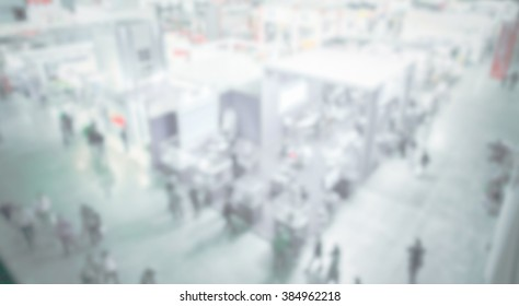 Trade show generic background, panoramic view, with an intentional blur effect applied.
