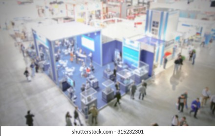 Trade show panoramic view, generic background, intentionally blurred post production.