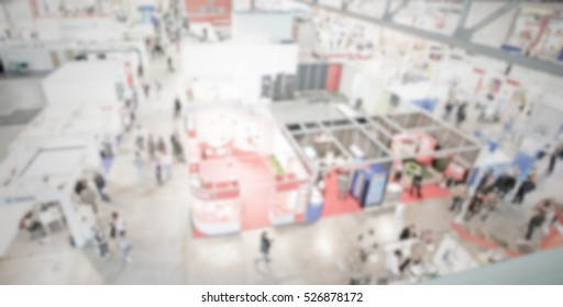 Trade show panoramic view, generic background with an intentional blur effect applied. Humans and location unrecognizable.