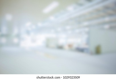 Trade show with people, background with an intentional blur effect applied.
