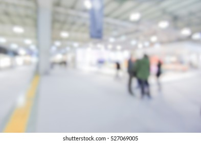 Trade show view, generic background with an intentional blur effect applied. Humans and location unrecognizable.