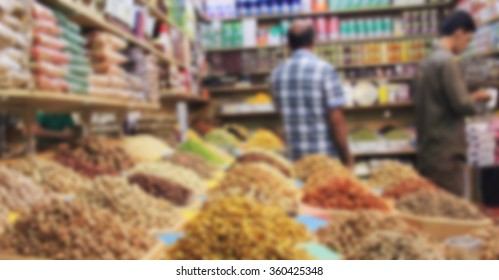 trade in spices and nuts on the counter, dried food baskets on the market for background, blurred