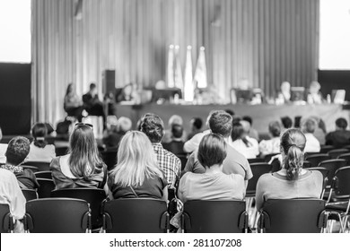Trade union advisory committee meeting . Audience at the conference hall. Black and white shot.