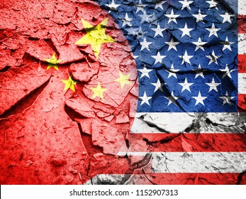 Trade war concept, USA flag against China flag, on dry cracked earth background