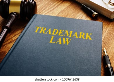 Trademark law and gavel on a wooden surface. Copyright concept.