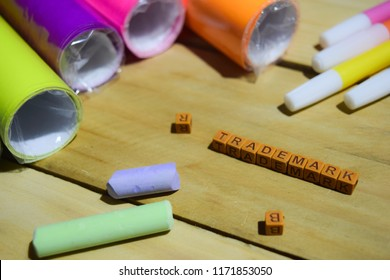 Trademark on wooden cubes with colorful paper and pen, Concept Inspiration on Wooden background