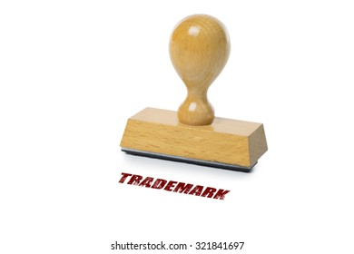 Trademark printed in red ink with wooden Rubber stamp isolated on white background