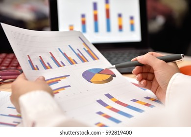 Trader Woman analyzing income graphs and charts. Business analysis and strategy concept.