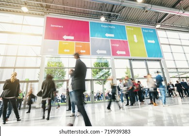 Tradeshow Visitors rushing in a modern hall