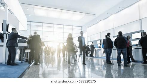 Tradeshow Visitors at Trade Fair Stands