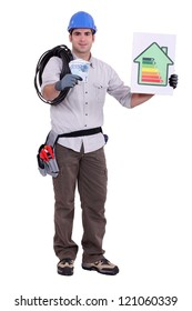 Tradesman holding a wad of money and an energy efficiency rating sign