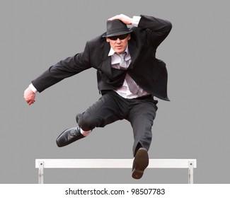 tradesman jumping over a hurdle
