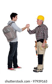 Tradesman making a pact with a young man