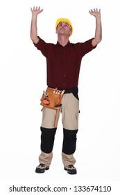 Tradesman pushing an object