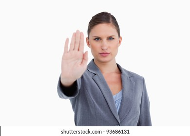 Tradeswoman showing her palm against a white background