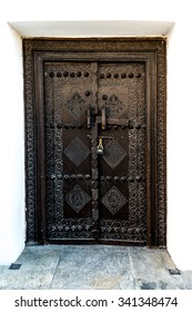 Tradiational carved wooden Arab doorway of a restored building in Muharraq, Bahrain.