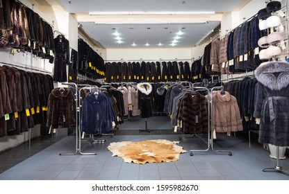 Trading floor of the fur shop, a large range of mink coats