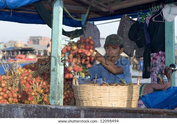 trading fruits on the floating market in Cai Rang, Vietnam