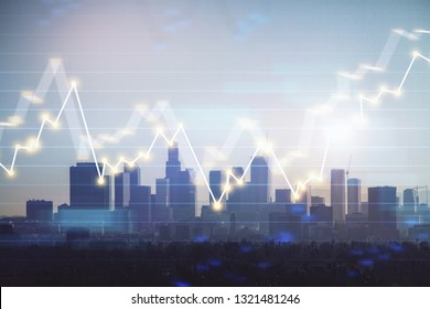 Trading graph on the cityscape at background. Business and financial concept. Double exposure. Los Angeles