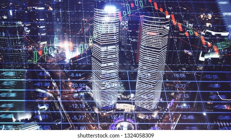 Trading graph on the cityscape at night background. Business and financial concept. Double exposure. Shanghai