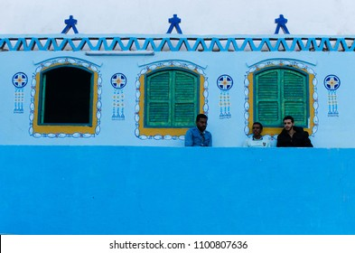 Tradional Nubian House and Nubian villagers are sitting in the front during winter time, Nubia - Aswan, Egypt - February 2018