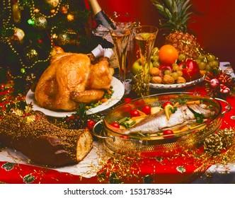 Tradirional Christmas Foods. Roasted Turkey; Roast Sea Bream and Chocolate Log Cake on red table.