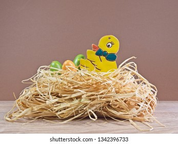 Tradition Easter chick with eggs in a straw nest