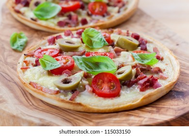 Tradition French tarte flambee with olive and basil