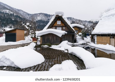 The tradition house and rice field with snow covered at the historic villages of Shirakawa-go and Gokayama in the winter. The Gassho-style house is steeply slanting thatched roof. Gifu. Japan. Asia.