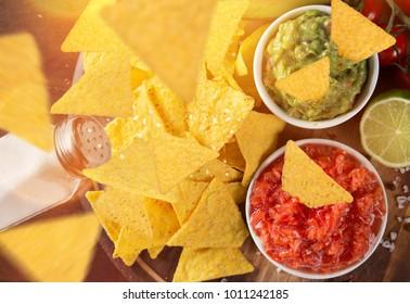 Tradition mexican guacamole and salsa dip, nachos tortilla chips, close-up.