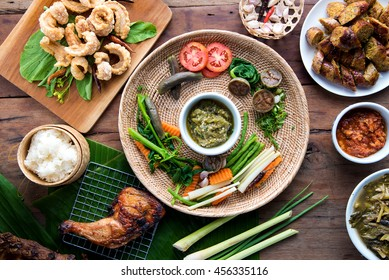 Tradition Northern Thai food. Thai cuisine nam prik or chili sauce, Thai sausages , deep fried pork skin. Thai food concept