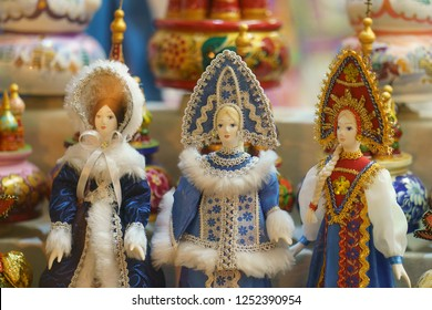 Tradition russian dolls wearing winter cloth