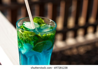 Tradition Summer drink blue mojito with lime mint and ice. outdoor