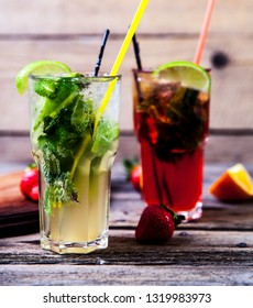 Tradition Summer drink mojito with lime and mint, strawberries a