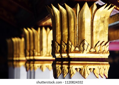 tradition texture of golden pillar in royal grand palace.