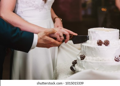 tradition, young couple cutting wedding cake