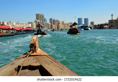 Traditional Abra ferry ride at the creek in Dubai, United Arab Emirates. Abra ferries in Dubai Creek.