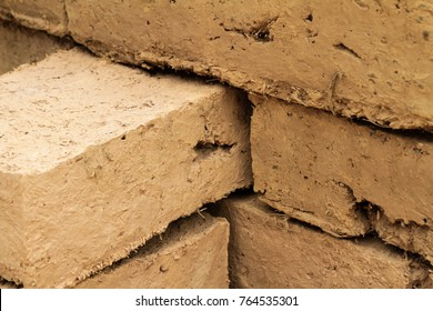 Traditional Adobe bricks, Mud bricks. Material for building cob house or clay house.