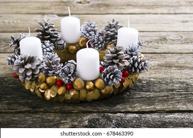 traditional advent wreath on weathered old wood table background