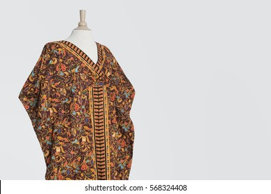 Traditional African dashiki on tailor's dummy over gray background