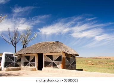 traditional african hut of the ndebele tribe with mud walls and thatch roof and decorated walls